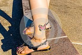 Fotografie32961731 Barevný Motýl Tetování Na Kotník Autor