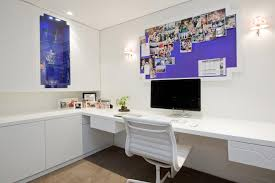 modern decoration home office features. This Spacious Home Office Features A White, Built-in L-shaped Desk With Modern Decoration N