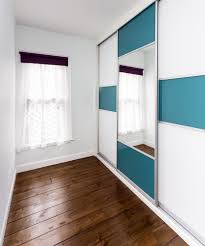 childrens fitted bedroom furniture. A Sliding Wardrobe With Coloured Panels In Bare Room Childrens Fitted Bedroom Furniture G