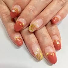 2月のデザインネイル オレンジ系とゴールドが とても良く合って素敵