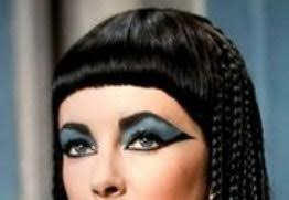 elaborate eye make up and wig worn by queen cleopatra in the cleopatra