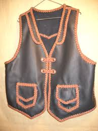this two tone vest is built with moccasin cowhide leather including for the braided lacing