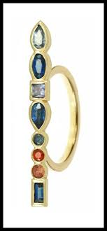 long stepping stone ring by ilana ariel with colorful gemstones set in yellow gold