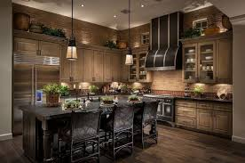 beautiful kitchen lighting. this beautiful kitchen has earth tone bricks lining the walls and a deep natural hardwood floor lighting u