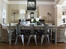 metal and wood dining room furniture. a reclaimed lumber table is mixed with metal tolix chairs and pictures dining room trend wood furniture