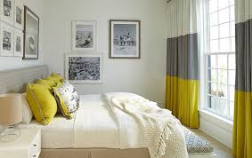 view in gallery gray and yellow bedroom with vintage black and white photograph on the walls design