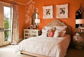 warm bedroom colors wall. orange warm bedroom colors with white bedding and wall decor mirrored nightstand p