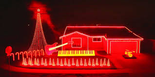 lighting a house. House Decorated With Christmas Lights And Instruments Lighting A T