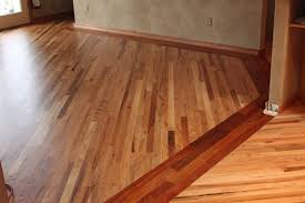 Two different wood floors in house with simple border Flooring