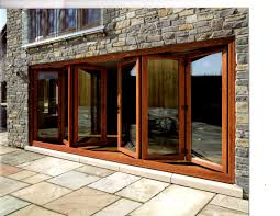 inspiring millworks bi folding wood clad patio rustic brown wooden bifold patio doors with glass jpg
