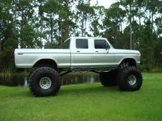 big old ford crew cab i want a monster truck and i want an older truck jus for beating around