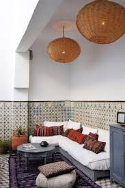 Here a traditional Moroccan table and lamp pair well with the modern settee  and white walls.