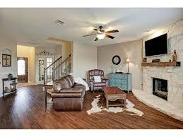 odd shape living room with corner fireplace