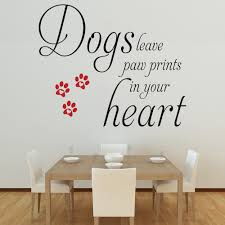 black and red dogs leave paw prints wall decal in a dining room