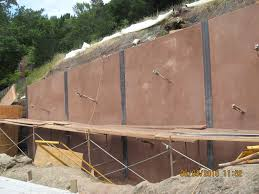 steel solr beam wall with colored shotcrete panels and tie backs