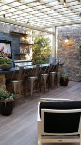 patio outdoor stone kitchen bar:  stunning outdoor living spaces style estate outdoor kitchen bar space with tv