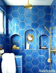 bold blue hexagon tiles with niches in the shower navy tile bathroom ideas