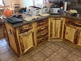 hand made rustic aspen log kitchen cabinets and built in wall e rack by ireland s wood custommade com