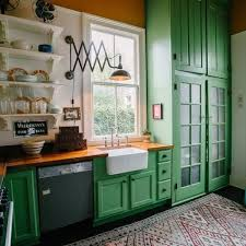 a bright green kitchen with butcher block countertops