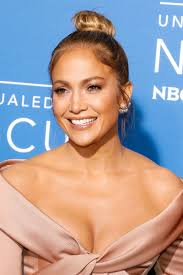 and here s how j lo looks with a similar hairstyle and a full face of makeup