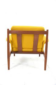 650 danish design armchair with teak frame sprung cushions and yellow upholstery