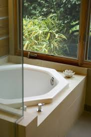 japanese soaking tub with seat. view full sizethe oregonianan asian-style soaking tub in an octagonal shape. japanese with seat