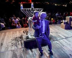 boaz michaelov holds his grandson moishe 2 as they dance around a giant ice