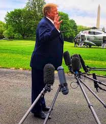 Image result for trump leaning forward