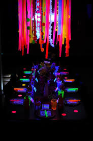 neon glow in the dark party table see more glow in the dark party ideas