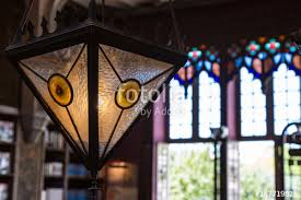 closeup of antique colorful glass chandelier in book