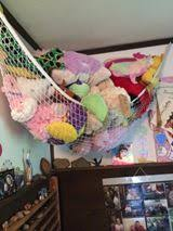 As you can see from the second picture Nicole uses a stuffed animal hammock  for many of her children's stuffed toys.