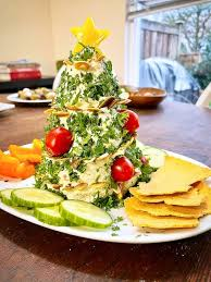 When you're satisfied with the shape, brush with butter and sprinkle the herbs on top. Christmas Tree Cheese Ball Appetizer Keto Low Carb Vegetarian