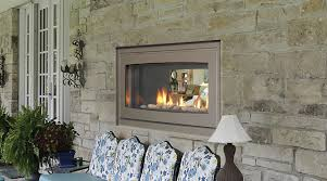 pretty isokern fireplace with beige frame on natural stone wall for terrace ideas