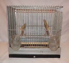 vintage wire bird cage with glass feeder water breeder cage
