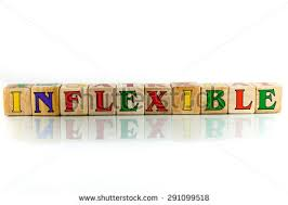inflexible. inflexible colorful wooden word block on the white background