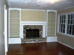 originally a full brick wall with the tiny fireplace in the middle now with built in bookshelves and a nice mantel good way to work around the ra
