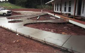 images of concret patios with wheel chair ramp new construction work