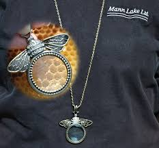 bee magnifying glass pendant necklace double tap to zoom