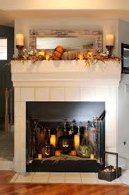 cozy folk art style fall decorations for the mantel and fireplace