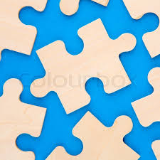 stock image of wooden puzzle pieces on blue background