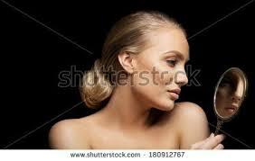 woman holding hand mirror. Woman Holding Hand Mirror M
