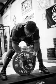 rogue olympic wl bar shown in use by rogue athlete cj mings black and white