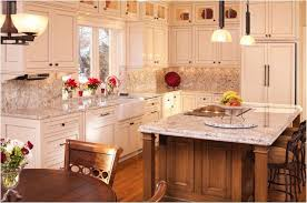 lighted glass cabinets above a white shaker door