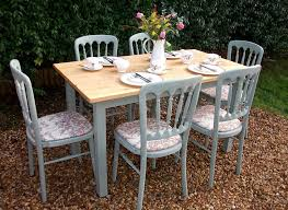 hand painted dining table and chairs. beautiful country farmhouse shabby chic pine dining table and six upholstered chairs. this set has been professionally painted with chalk paint hand chairs a
