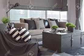 striped sofas living room furniture. Stock Photo - Striped And Black Leather Pillows On The Sofa In Modern Industrial Style Living Room Sofas Furniture