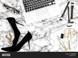 feminine office supplies. Feminine Accessories Notebook Shoes Office Supplies On Bright Marble Table Background. Fashion Flat Lay For