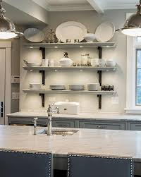 statuary marble kitchen shelves with iron brackets