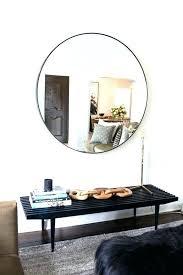 circle mirrors on wall living room