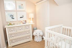 White and Tan NUrsery with White Elephant Wicker Hamper