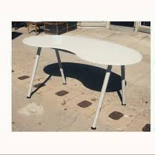 in an excellent condition ikea galant white desk top and grey legs desk top made from toughened glass ergonomic shape kidney bean shape with smooth